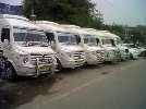 16 seater tempo traveller hire in noida 09953851234,12 seater tempo traveller hire in ghaziabaad - logo