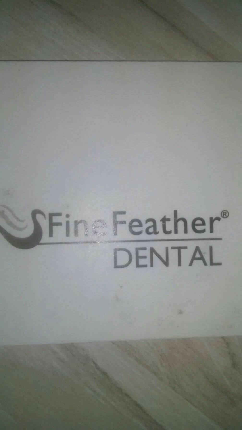 FineFeather Dental@Ahmedabad - logo
